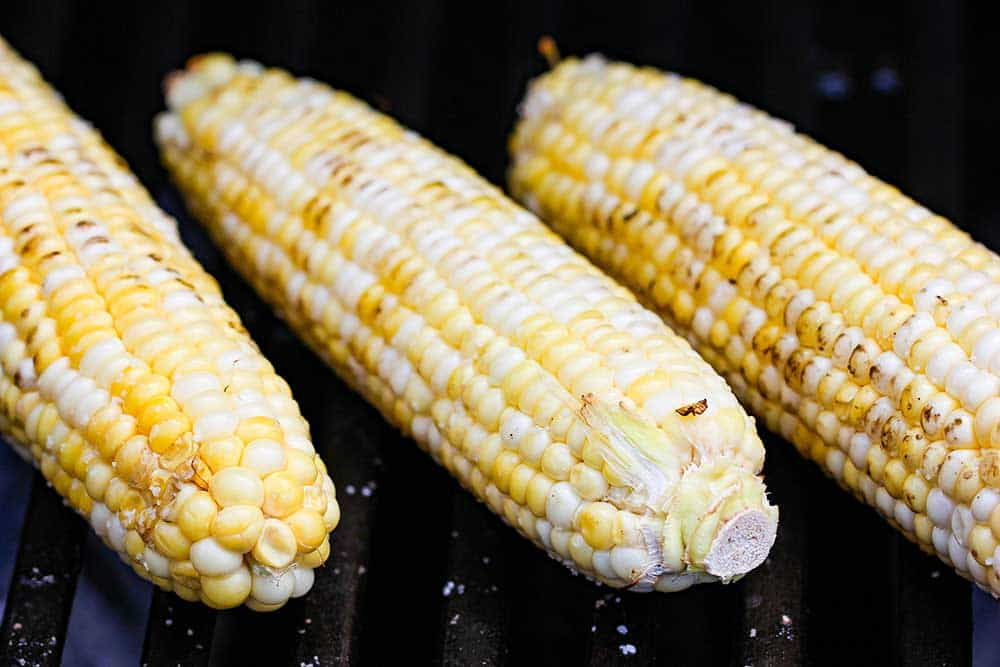 Grill the corn until some kernels are just starting to turn brown.