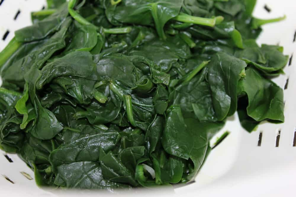 cooked spinach ready for fresh spinach pasta