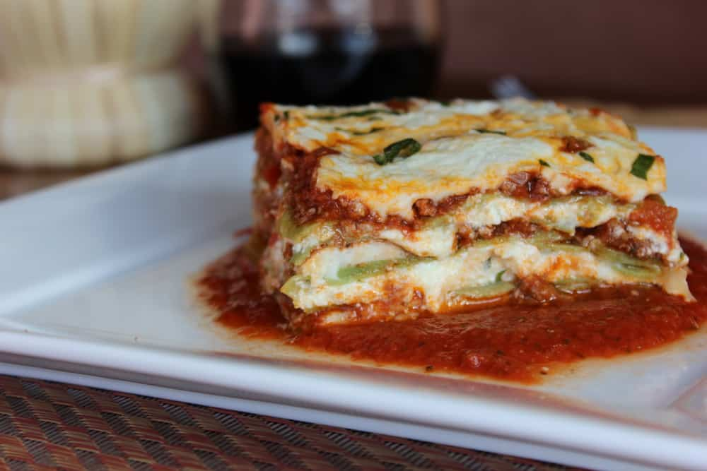rustic lasagna with fresh spinach pasta and bolognese sauce