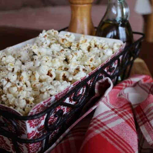 Popcorn with Garlic, Thyme and Black Pepper in a red and white basket next to a red and white patterned napkin