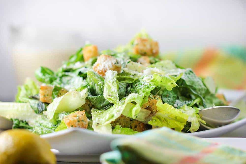 A close up view of a classic Caesar salad on a plate.