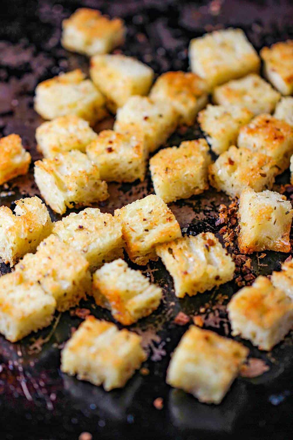 Baked crispy croutons on a baking sheet