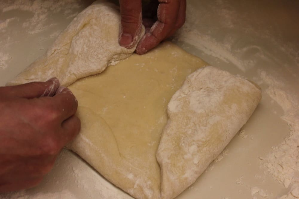Homeade bread: Fold the dough in from the edges