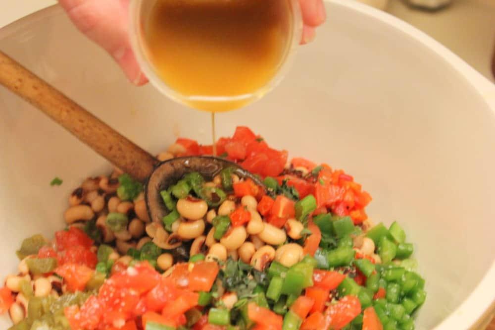 Texas Caviar - In goes the fresh garlic balsamic vinaigrette