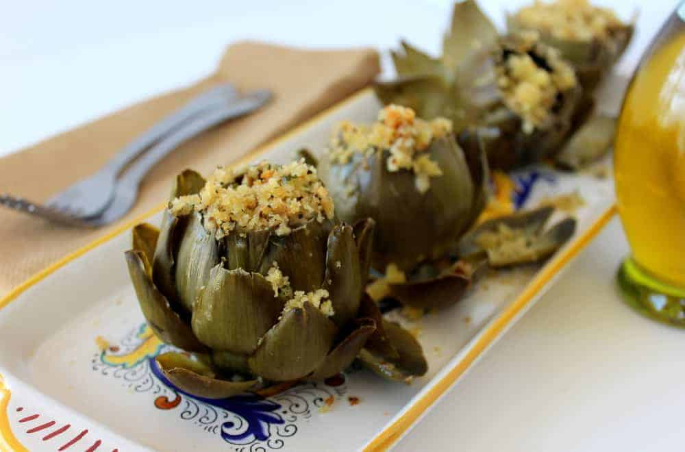 Italian Style Braised Artichokes on a white patterned plate
