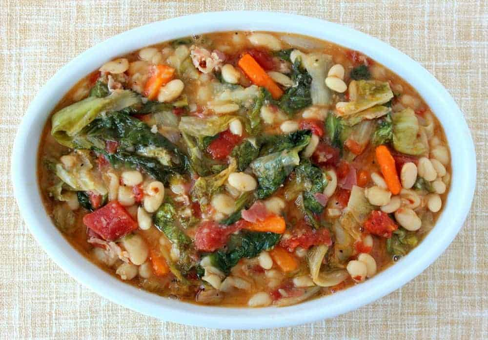 A white bowl of Braised Escarole with Cannellini Beans