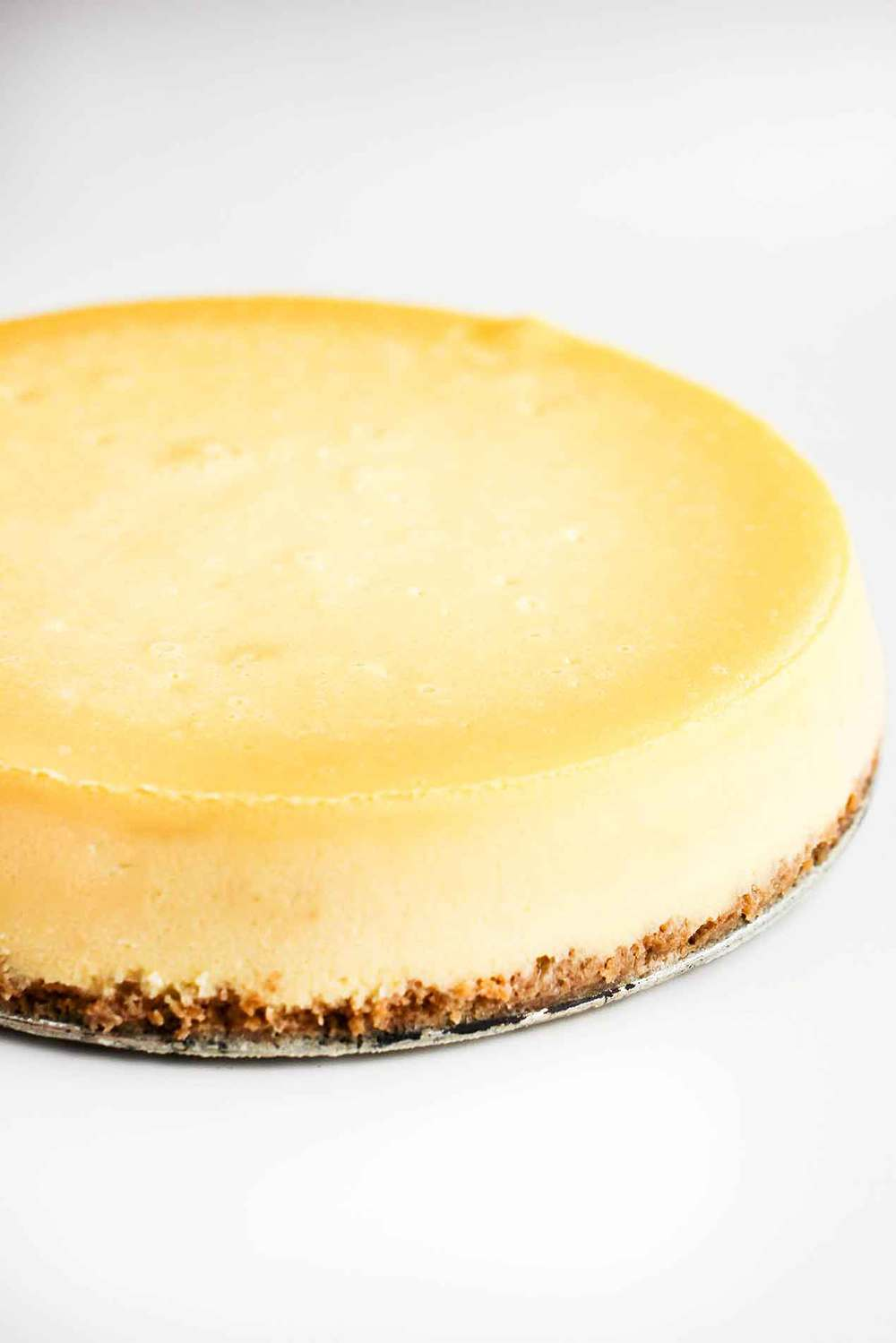New York Cheese Cake on a tin pie plate.