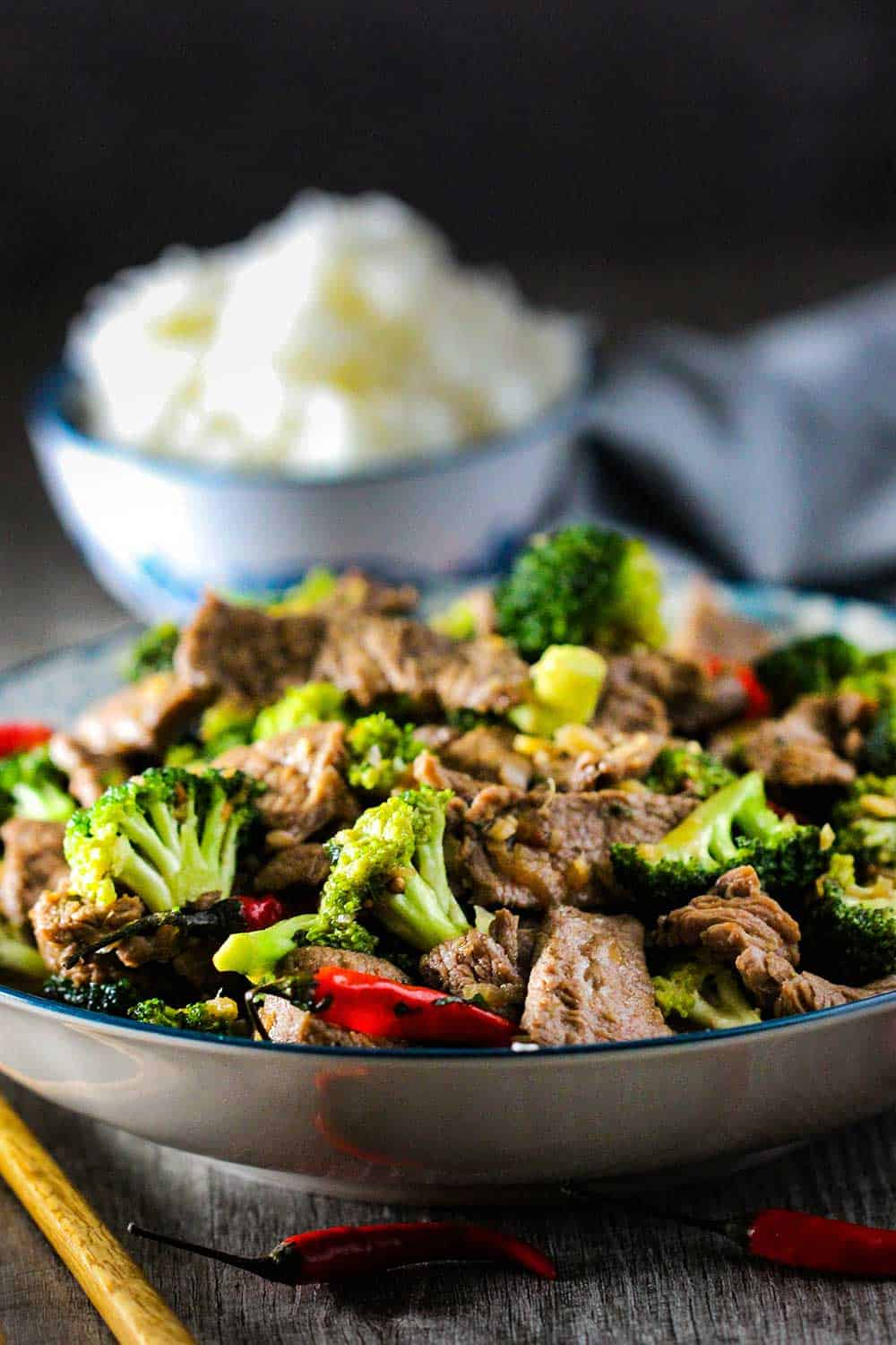 A bowl of beef and broccoli stir-fry with Jasmine rice.