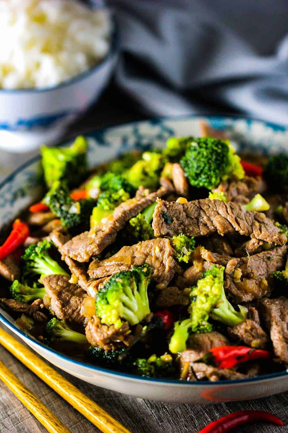 Cooked beef and broccoli stir-fry in a large serving dish.