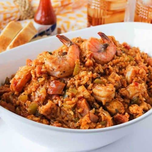 A white bowl with authentic jambalaya
