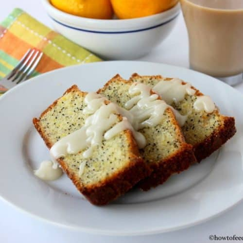 Incredible lemon poppy-seed pound cake on a white plate next to a patterned napkin and fork