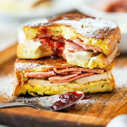 The Best-Ever Monte Cristo Sandwich on a wood cutting board
