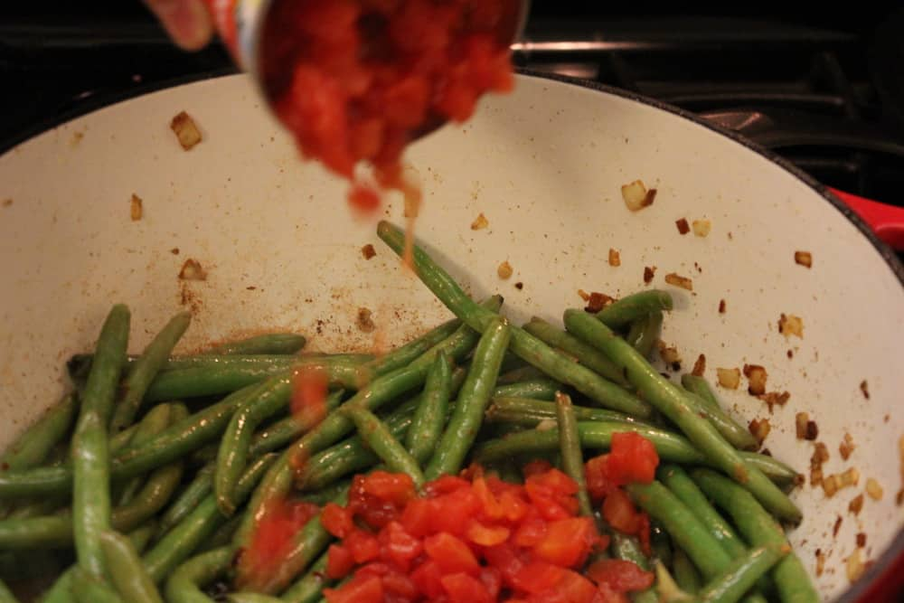 Tomatoes and onion into the green beans