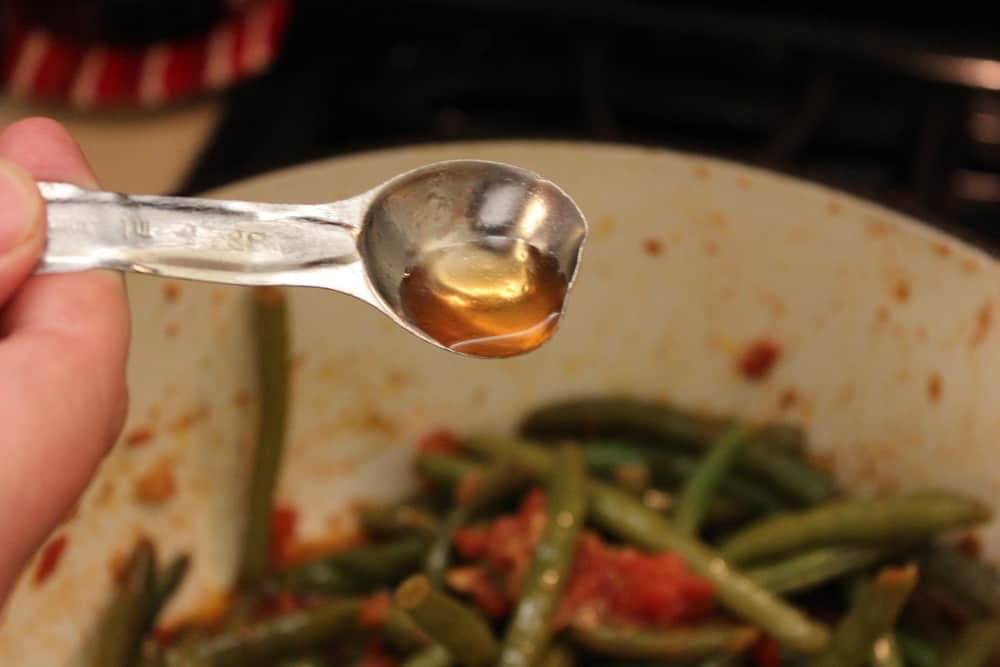 Red wine vinegar added to braised green beans