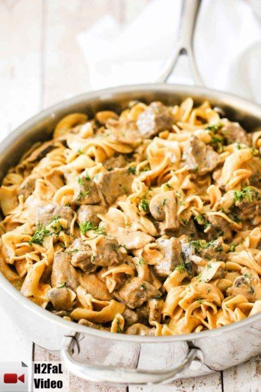 A large silver saucepan filled with gourmet beef stroganoff