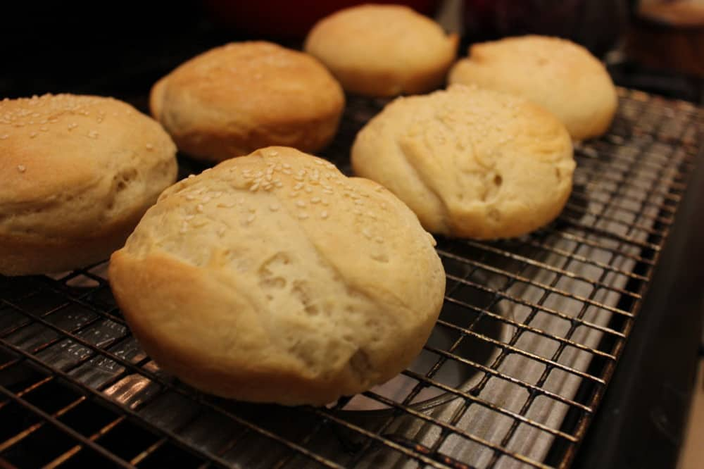 perfect hamburger buns cooling on a rack