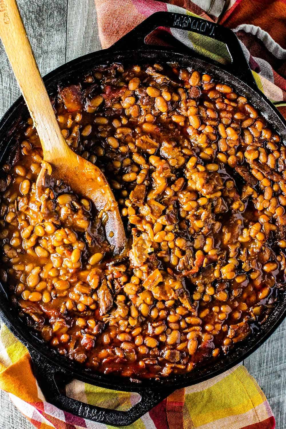 Stir the baked beans with a wooden spoon after they have baked.