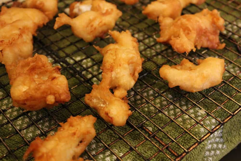 Fried fish draining on a rack