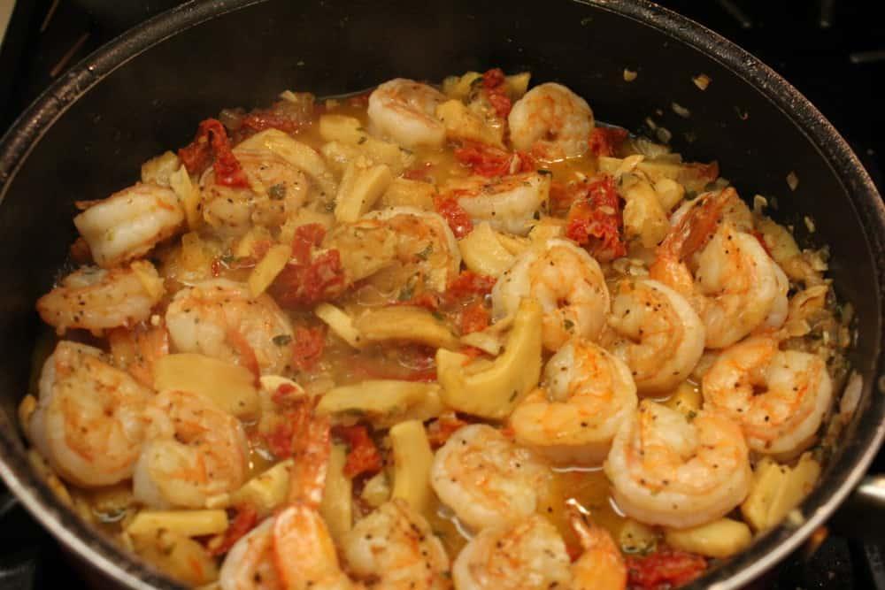 Linguine with shrimp and artichoke simmering