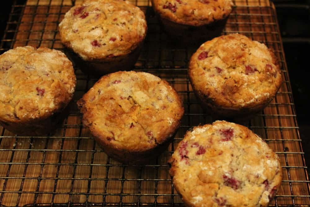 Muffins sitting on a cooling rack right out of the oven