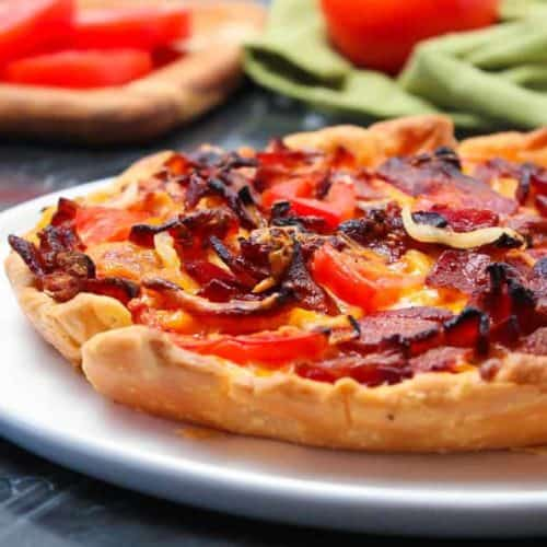 Tomato Cheddar and Bacon Pie on a white plate