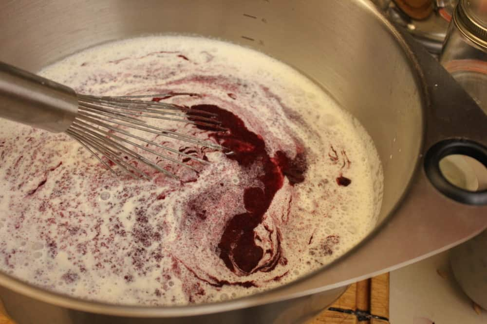 Mixing the cream with the eggs and the blueberry sauce