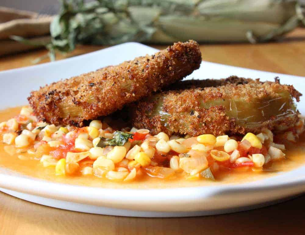 Fried green tomatoes on corn and tomato saute