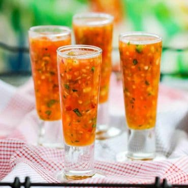 Pour gazpacho into chilled shot glasses for serving.