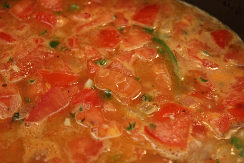 Simmering tomatoes with onion, jalapeno, pablano, garlic...and pure deliciousness.