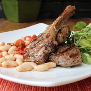 Grilled marinated lamb chops on a white plate