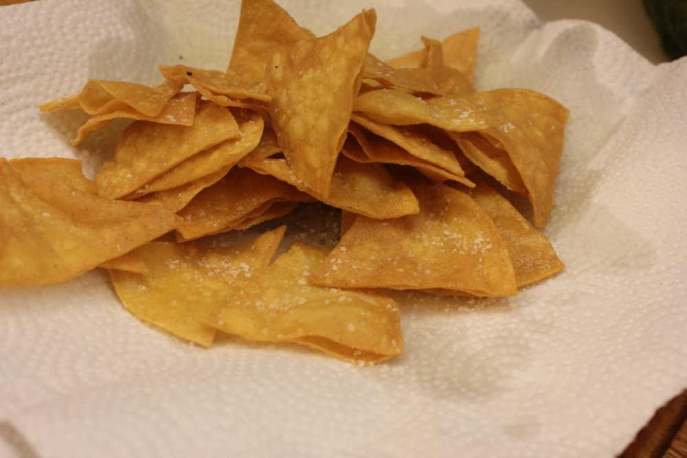 Quick fry yellow corn tortillas then lightly salt...amazing!