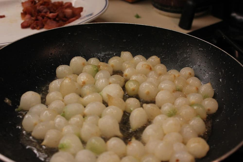 Saute the pearl onions in the pork fat