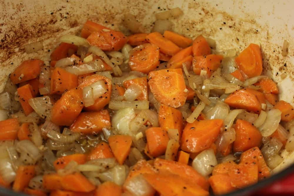 Simmer the carrots and onions and garlic