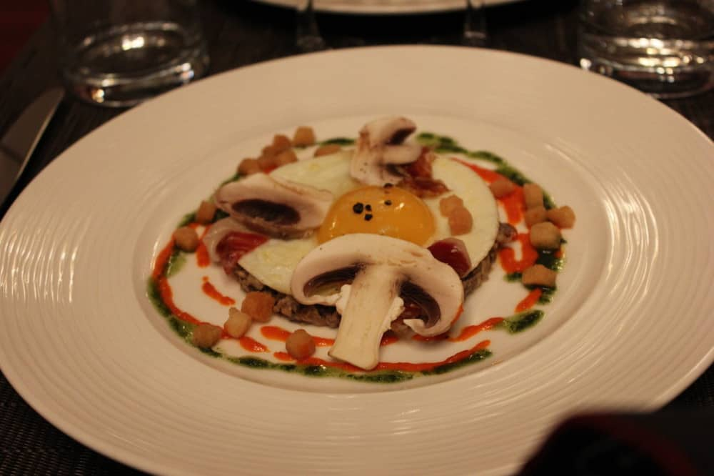 Salt and Pepper fried egg, raw and sauteed mushrooms, piquillo flesh, basil and shavings of Pata Negra
