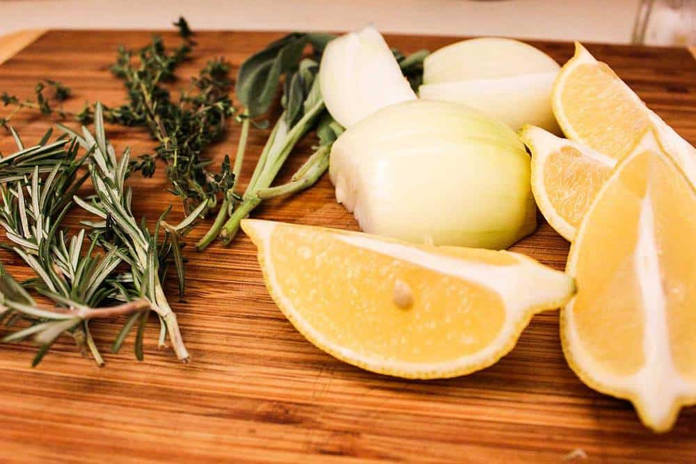 Herbs, onions and lemons for cooking the perfect turkey