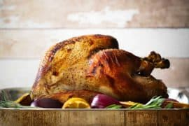 The perfect roasted turkey on a white platter