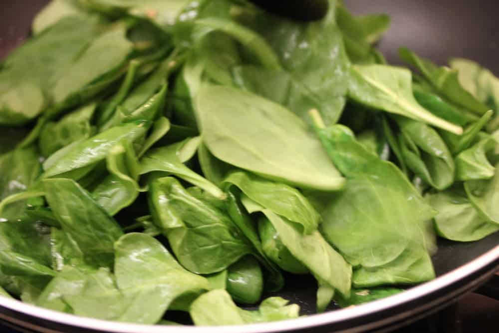 Saute the spinach until wilted