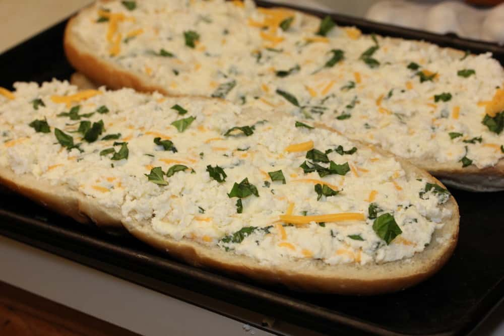 Top with cheese and chopped herbs (like basil) - ready for the oven!