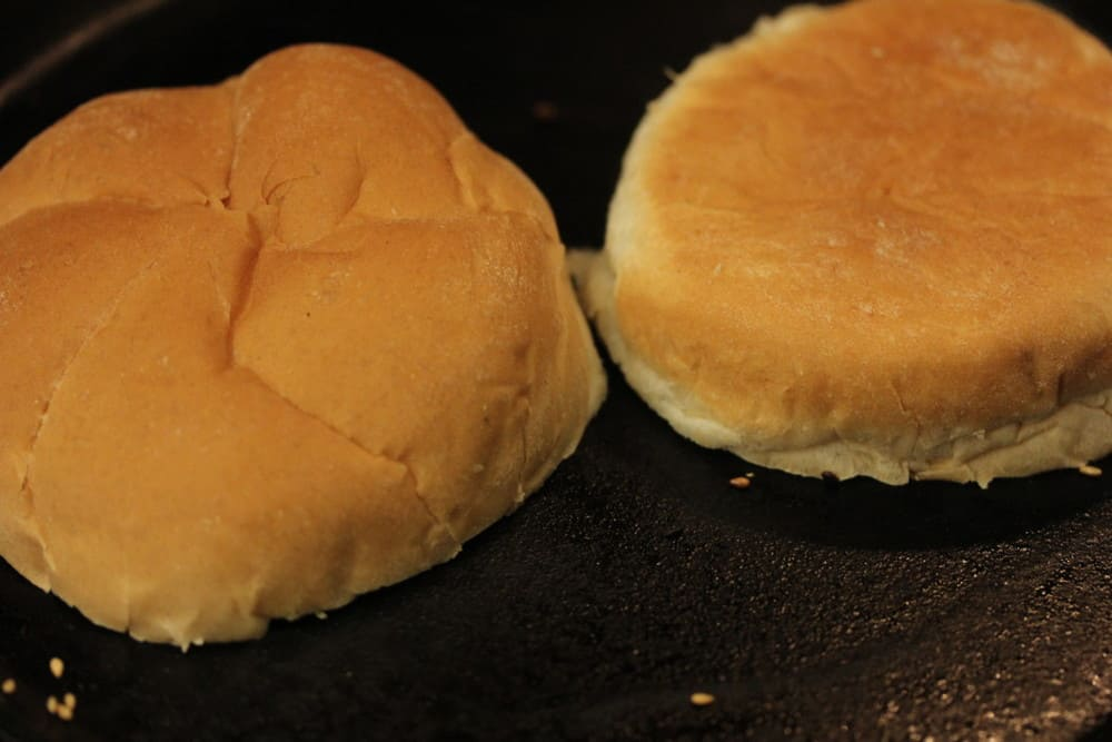 Toast a nice sturdy bun, such as Kaiser roll.