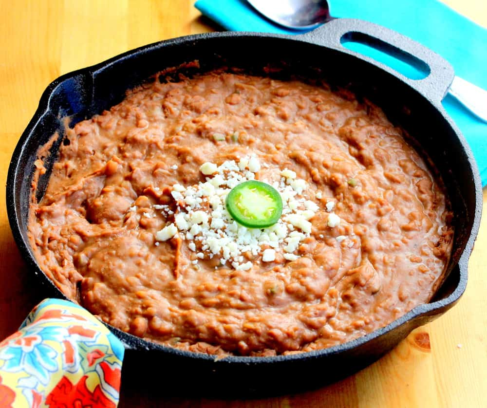 Easy gourmet refried beans in a large skillet