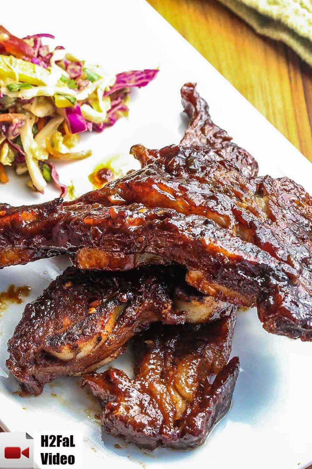 Asian Braised Short Ribs on a white platter with Asian slaw