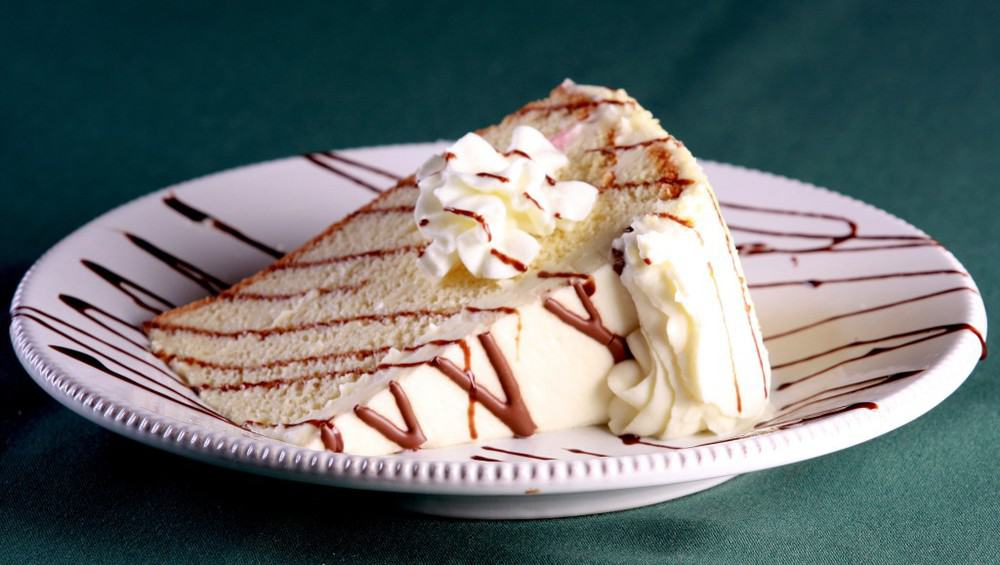 Tres Leches Cake: Traditional Mexican Cream Cake with Rum. Rum Yum!