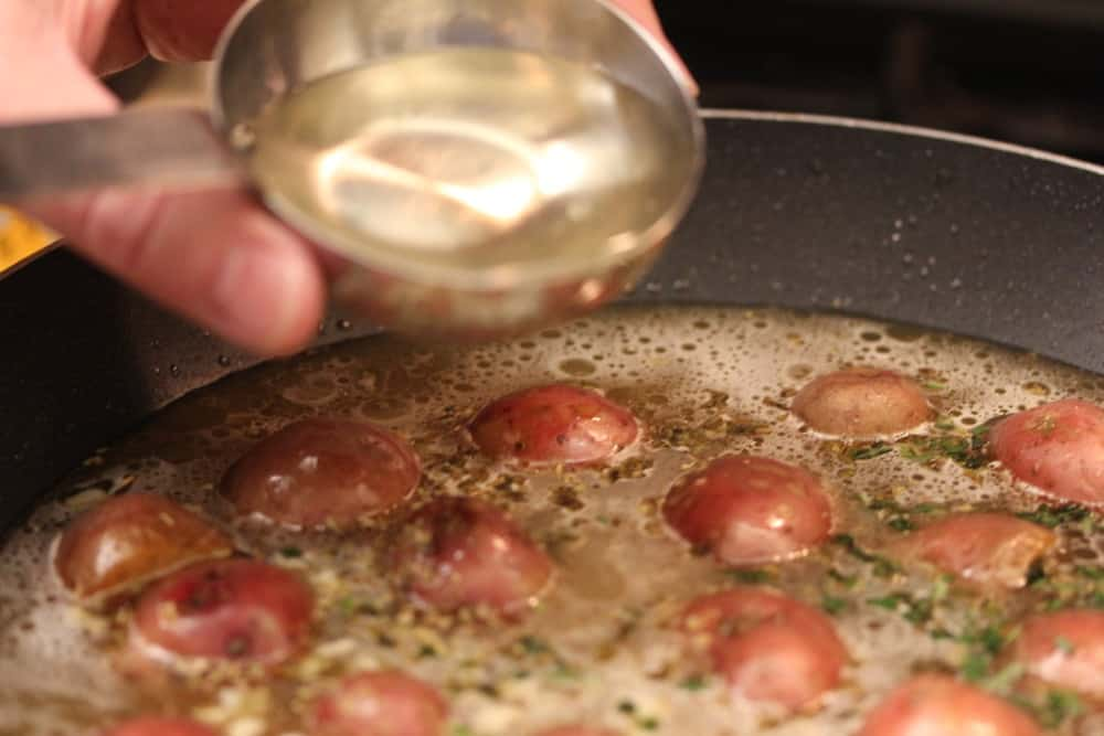 Flavors deepen with herbs, chicken stock and white wine
