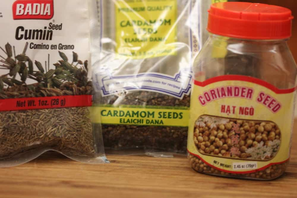 Start with cumin seeds, cardamom seeds and coriander seeds