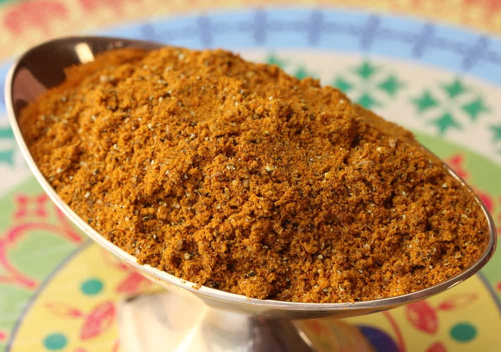 Homemade curry powder in a small golden vessel.