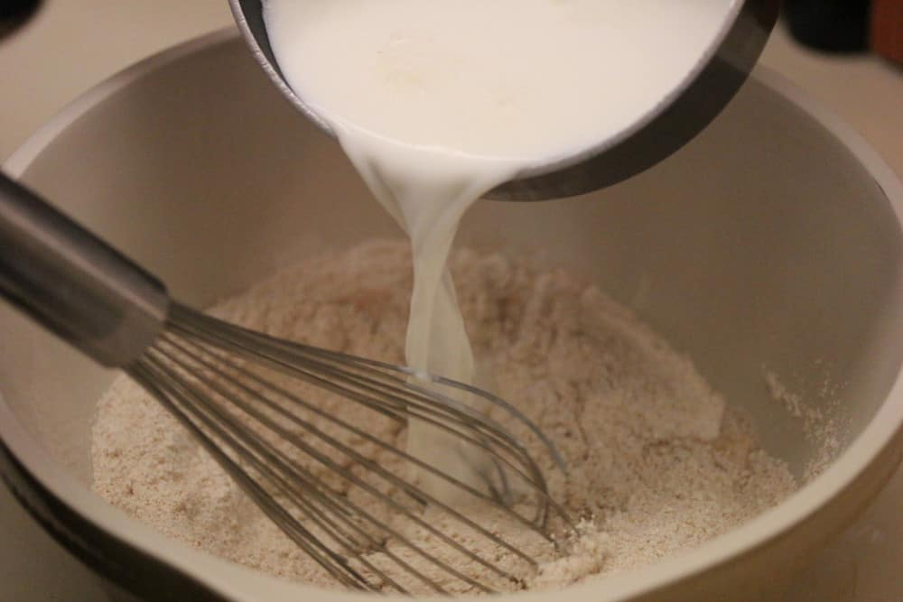 Cooled milk goes into the wheat flour blended with yeast