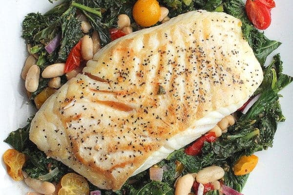 Halibut with braised kale, beans & tomatoes