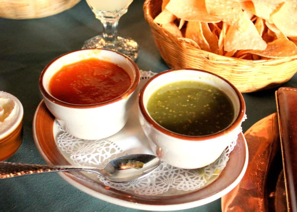 Complimentary red salsa, warm salsa verde and tortilla chips