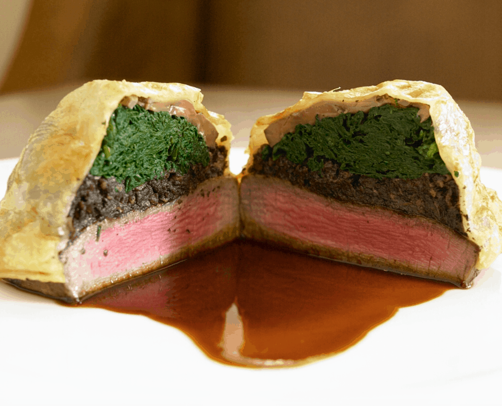 Sauteed spinach, duxell, foie grais, and beef tenderloin