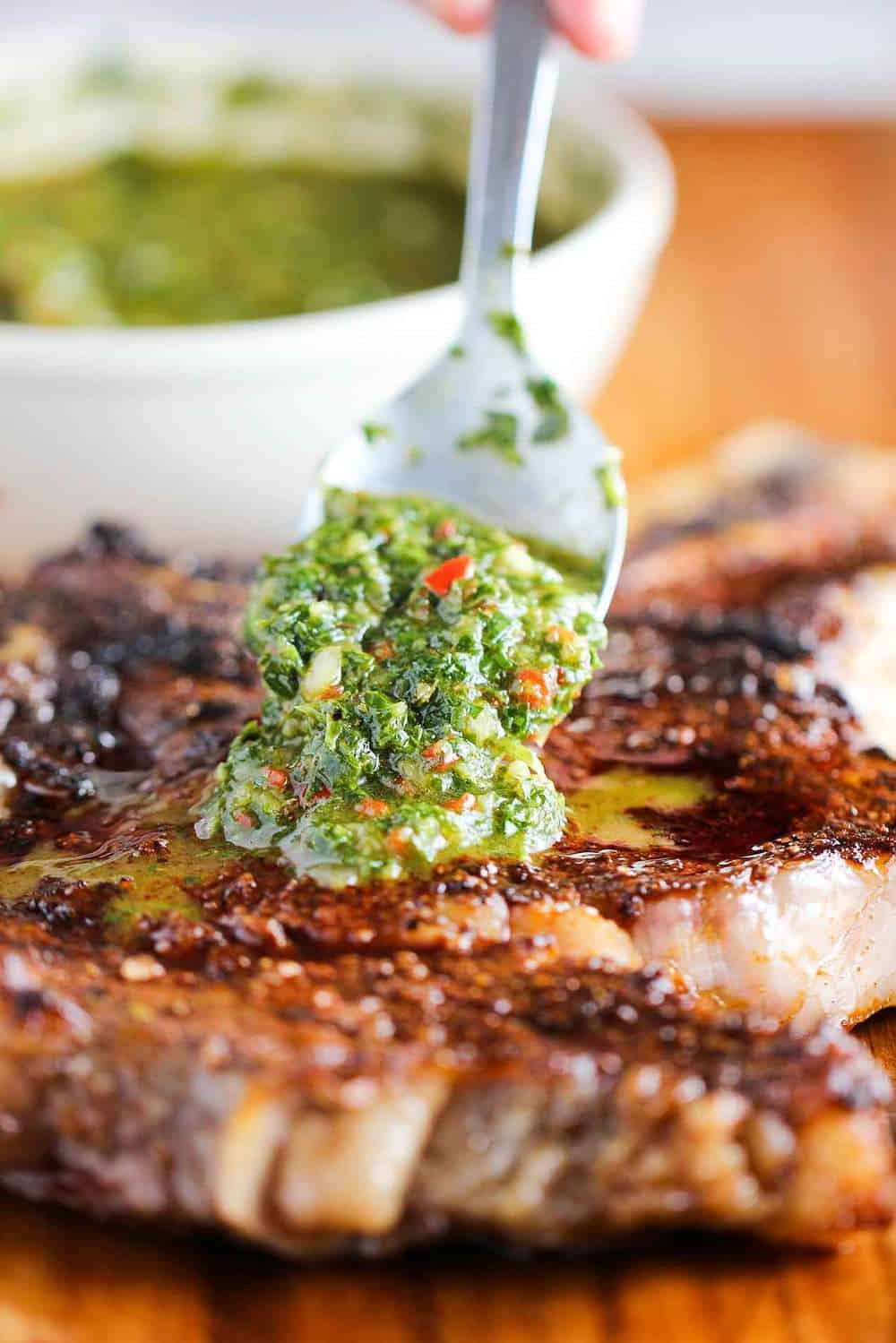 grilled cowboy ribeye steak with chimichurri sauce